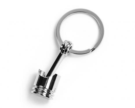 Dekoratyvinio stūmoklio rakto pakabukas
